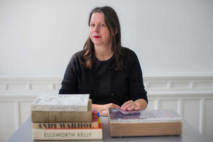 irma boom with some favourite books in her office in amsterdam