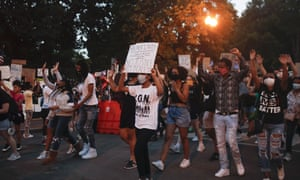 Demonstrators protest Monday, June 8, 2020, near the White House in Washington, over the death of George Floyd.