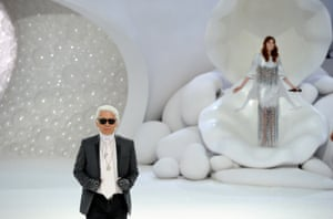 Lagerfeld receives audience applause as Florence Welch of Florence and the Machine performs during the Chanel Ready to Wear Spring/Summer 2012 show