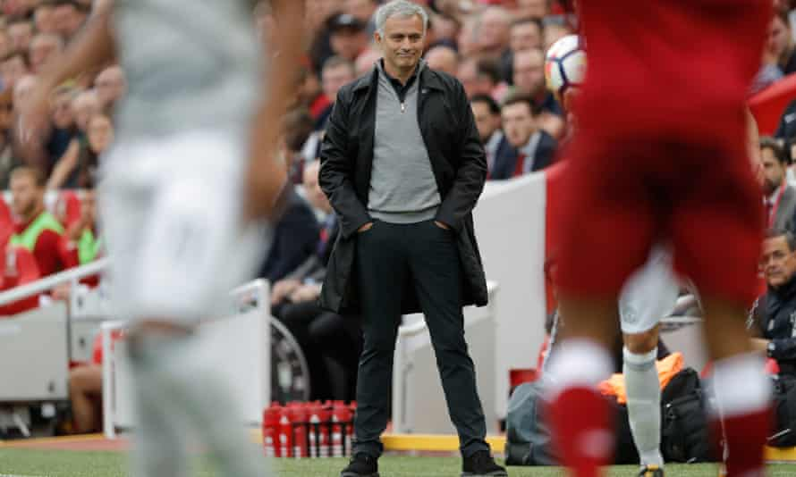 José Mourinho shows a wry smile on the touchline as he watches Manchester United's goalless draw with Liverpool at Anfield.