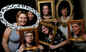 A groups look through picture frames to camera