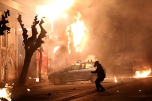 In Athens, molotov cocktails are hurled against Greek riot police