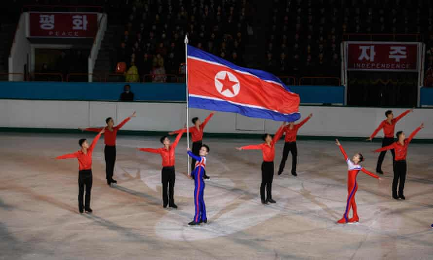 Olympic ice skater Kim Ju Sik (centre L) of North Korea holds a national flag during celebrations marking the birthday of late North Korean leader Kim Jong Il, in Pyongyang. North Korea will not attend the forthcoming Olympic Games in Tokyo, Pyongyang's sports ministry said on 6 April 2021, citing the risks of coronavirus infection.