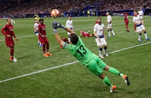 Liverpool's goalkeeper Alisson dives to make a save