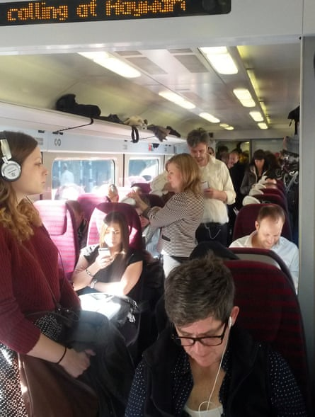 Passengers standing in a crowded carriage on board a rush-hour Southern train from Brighton to London.