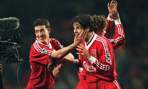 Liverpool's Robbie Fowler celebrates with Jamie Redknapp at the end of the match.