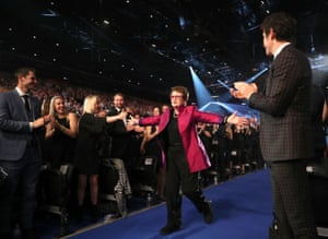 Billie Jean King walks up to receive her award.