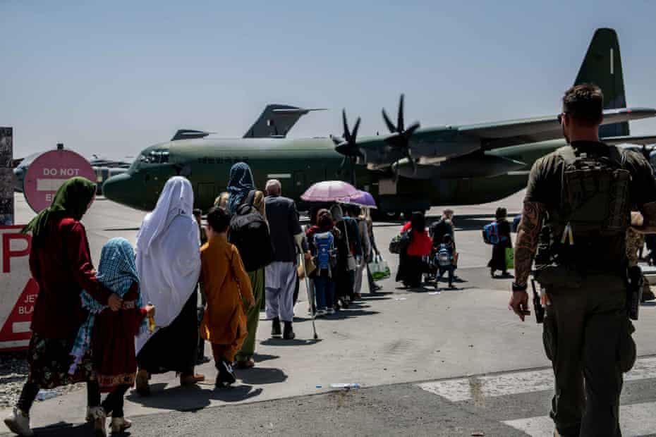 Afghans fleeing their country are evacuated from Kabul airport after the Taliban take control of the city.