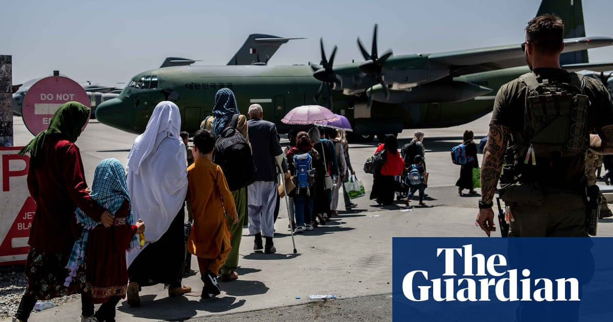 Some slept, some cried, all were now refugees: inside one of the last Afghan airlifts