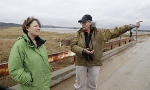 Resident Fran Karr, right, points out to Amy Klobuchar the flooded areas around her home in Pacific Junction, Iowa, in March. 'She's your classic retail politician,' one analyst observed.