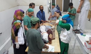Medical personnel treating an injured man in a Médecins sans Frontières hospital in Kunduz on Saturday after an airstrike on the facility