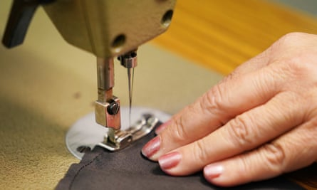 A worker uses a sewing machine.