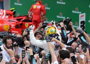 Hamilton celebrates after winning the race.