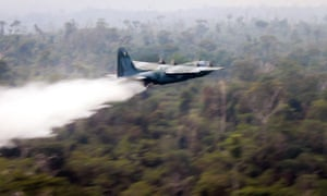 A Hercules C-130 plane dropping water to fight fires in the state of Rondonia, Brazil.