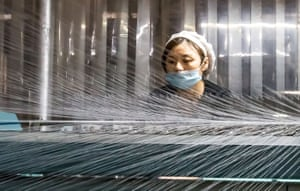 A woman works in a textile factory in Nantong, China