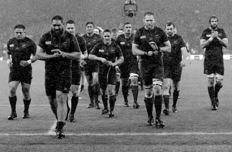 The All Blacks come off the pitch after their narrow victory against South Africa
