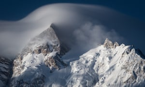 North peak of Nanga Parbat moutain massif covered by cloud