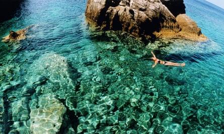 Woman swimming in the sea, Greece