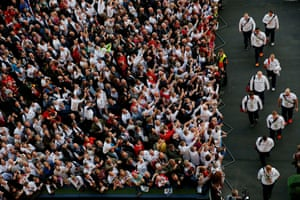 The fans cheer the arrival of the England players and coach Stuart Lancaster.
