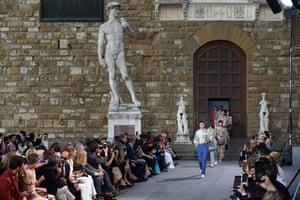 Hero Fiennes-Tiffin walks down the runway at a fashion show in Florence, Italy