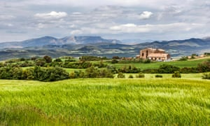 Casa Albets with green wheat fields in foreground in Andalucía, Spain