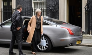 Theresa May returning to Number 10 after delivering her Commons statement.
