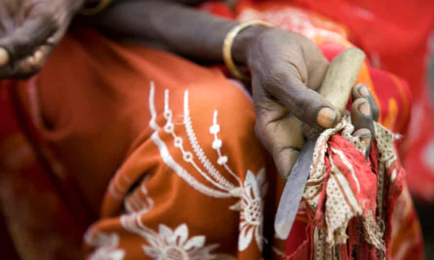 A cutter holding the tool she used to perform the procedure at a community meeting in Afar, Ethiopia.