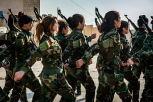 The all-female Peshmerga unit Daughters of the Sun drill at their base in the Sinjar province of Iraqi Kurdistan in preparation for fighting Isis.