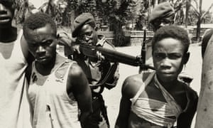 suspected Lumumbist freedom fighters being tormented before execution, Stanleyville, 1964.