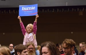 "Five-year-old Courtney Skinner holds up a ""Bernie Sanders for President"" sign at the Juneau Democratic Caucus."