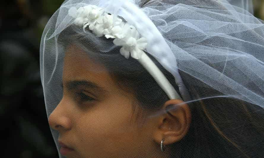 A young actress plays the role of Giorgia, 10, forced to marry Paolo, 47, during an event organised by Amnesty International to denounce child marriage.