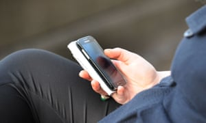 A woman using a mobile phone