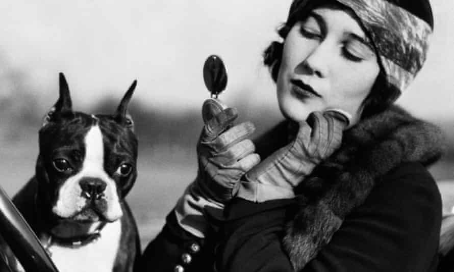 1920s flapper in a sportscar with her dog
