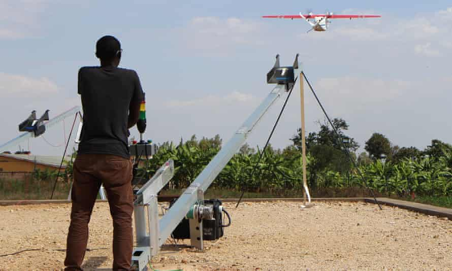 A technician of robotics company Zipline launches a drone