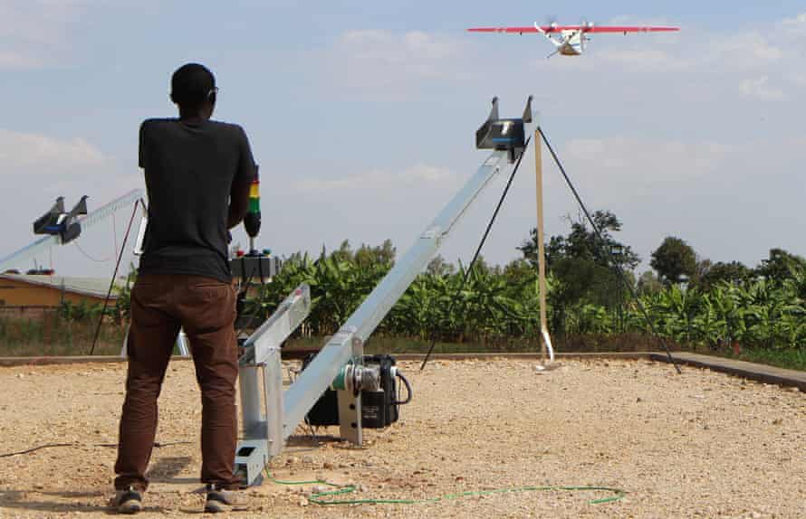 A Zipline worker technician launches a drone in Muhanga