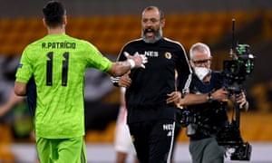 Wolves manager Nuno Espirito Santo celebrates victory with his keeper Rui Patricio.