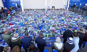 Supporters pay their respects outside Leicester City's home ground.