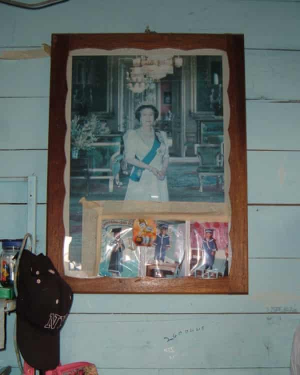 A portrait of Queen Elizabeth in a Caribbean home