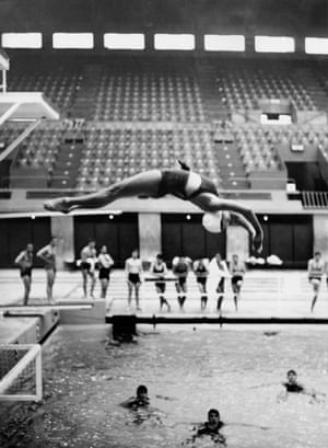 Diver Denise Newman trains for the women's diving championships at the Empire Pool, 1938