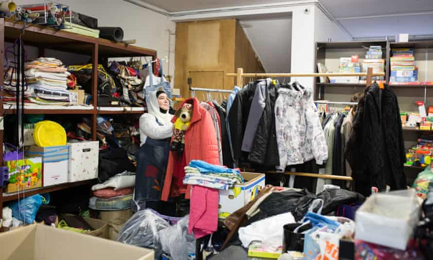 Senada inspects and stores discarded useable items in the storage of the Reuse center on May 8, 2019.