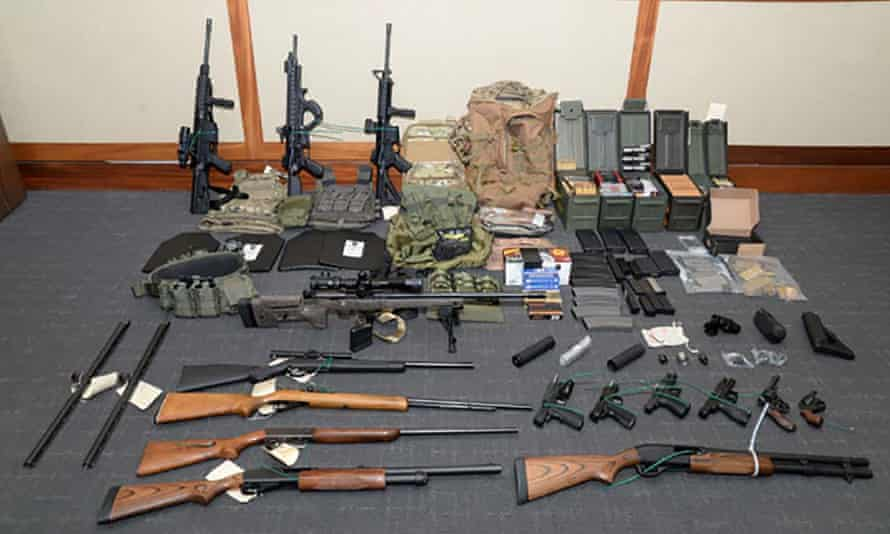 Law enforcement officers seized 15 guns and 1,000 rounds of ammunition from Christopher Hasson's home in Silver Spring, Maryland.