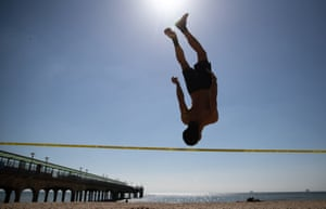 Boscombe, EnglandA slackliner practices his skills on the beach in Dorset. The hot weather which baked much of the UK this week is set to give way to a chilly Easter weekend