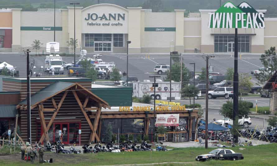 Motorcyles sit in the parking lot of the Twin Peaks restaurant on Tuesday, two days after the motorcyle gang shootout in Waco, Texas.