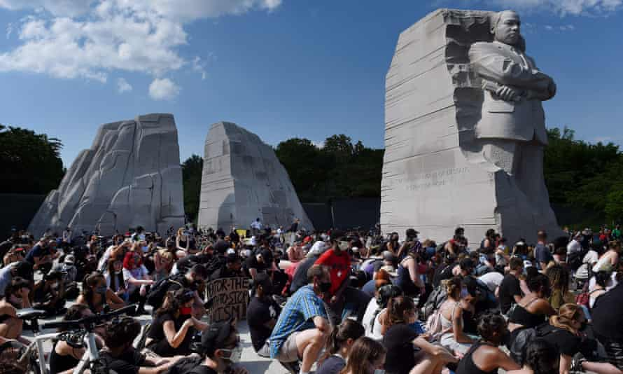 Demonstrators gather at The Martin Luther King Jr. Memorial in Washington DC on Thursday.