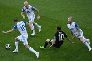 Lionel Messi loses possession as Iceland's midfielders Aron Gunnarsson and Gylfi Sigurdsson surround him during the 1-1 draw at the Spartak Stadium