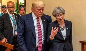 Donald Trump walks with Theresa May at the G7 summit in Taormina, Sicily