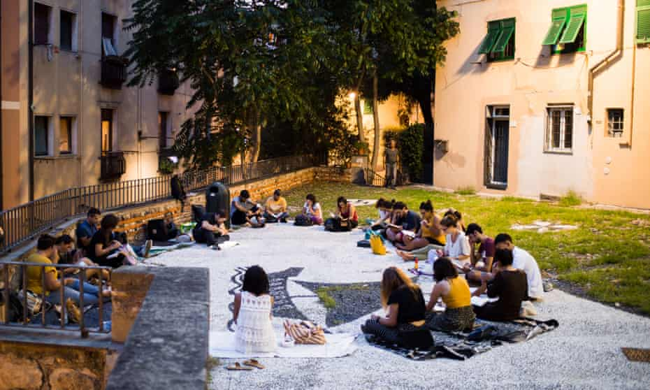 Members of Silent Book Genova, a chapter of the global Silent Book Club, where members gather to read whatever book they want, and in silence.