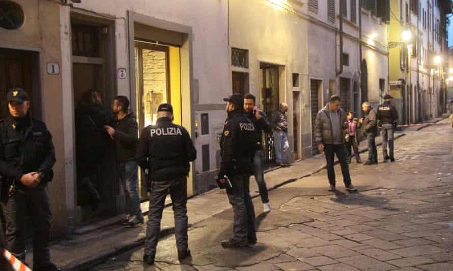 Police outside Olsen's building in Florence