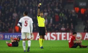 Referee Paolo Tagliavento shows a yellow card to Shir Tzedek