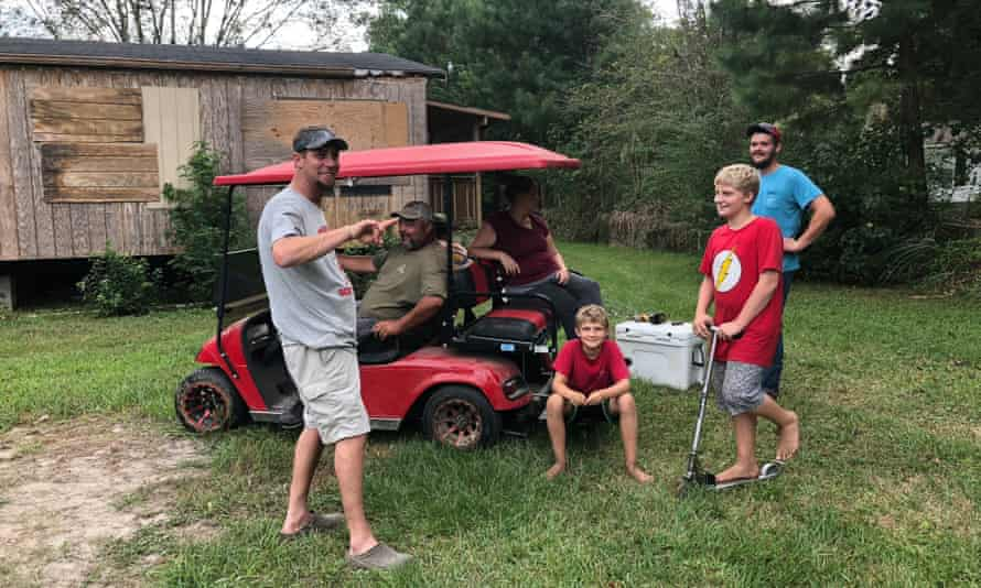 Neighbors in Rice's Creek chat outside Alex Tatum's home near coastal North Carolina a day before Hurricane Florence was expected to hit.